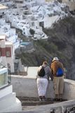 Elderly couple in Thira on Santorini. Tourism, travel and people concept - happy senior couple stock image