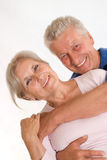 Elderly couple together on a white Stock Image