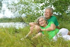 Elderly couple with toy sheep Royalty Free Stock Photos
