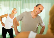 Elderly couple with trainer Royalty Free Stock Image