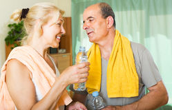 Elderly couple after training Royalty Free Stock Photo