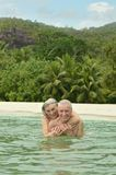 Elderly couple  at tropical beach Royalty Free Stock Image