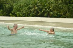 Elderly couple  at tropical beach Royalty Free Stock Images