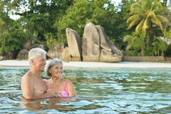 Elderly couple  at tropical beach Royalty Free Stock Photography