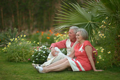 Elderly couple  in tropical garden Stock Image