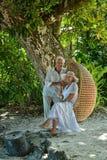 Elderly couple  in tropical garden Royalty Free Stock Photos