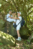 Elderly couple  in tropical garden Stock Photos