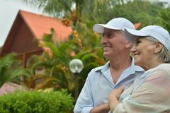 Elderly couple  in tropical garden Stock Photography