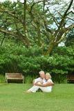 Elderly couple  in tropical garden Royalty Free Stock Photo