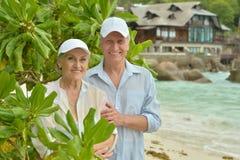 Elderly couple  in tropical garden Stock Images