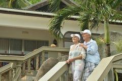 Elderly couple  in tropical garden Royalty Free Stock Image