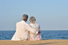 Elderly couple at tropical resort Royalty Free Stock Photography