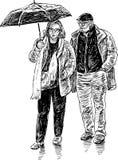 Elderly couple with an umbrella Stock Photo