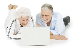 Elderly couple using laptop Royalty Free Stock Photography