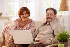 Elderly couple using laptop computer Royalty Free Stock Image