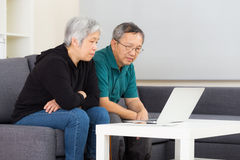 Elderly couple using laptop computer Stock Photo
