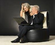 Elderly couple using laptop Stock Photo