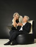Elderly couple using laptop Stock Photography