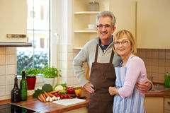 Elderly couple with vegetables Royalty Free Stock Images