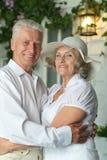Elderly couple on veranda Stock Photo