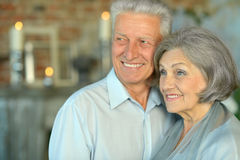 Elderly couple in vintage interior Royalty Free Stock Photo