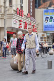 Elderly couple walk in city center, Shanghai, China Stock Photos