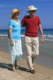 Elderly couple walking stock photos