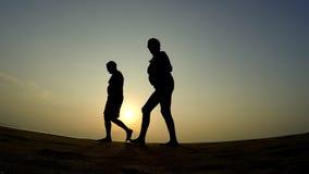 Elderly couple walking on the beach. stock video