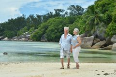 Elderly couple walking. Happy elderly couple walking on  tropical beach Stock Images