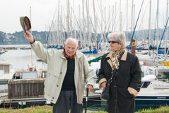 Elderly couple walking at the harbor Royalty Free Stock Photos