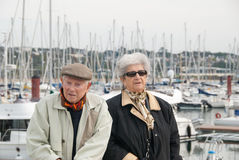 Elderly couple walking at the harbor Royalty Free Stock Images
