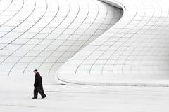 Free Elderly Couple Walking Near Modern Buildings Stock Image - 109980601