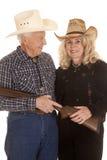 Elderly couple western gun close Stock Images
