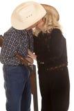 Elderly couple western gun kiss Stock Images