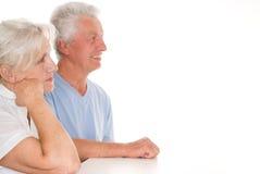 Elderly couple  on a white Royalty Free Stock Photos