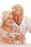 Elderly couple on a white Stock Images