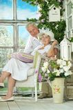 Elderly couple on wooden porch Royalty Free Stock Image