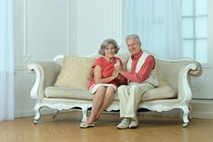 Elderly couple on wooden porch Stock Photo