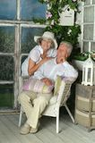 Elderly couple on wooden porch Royalty Free Stock Images
