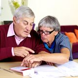 Elderly couple working with documents and taxes Royalty Free Stock Images