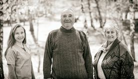 Elderly couple and young caregiver. Black and white photo of happy elderly couple and young caregiver Royalty Free Stock Images