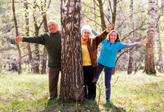 Elderly couple and young caregiver Stock Images