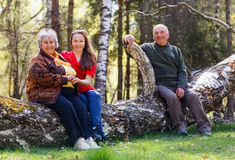Elderly couple and young caregiver Royalty Free Stock Photo