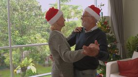 Elderly couples dancing in the air on Christmas Eve, the concept of lasting love, family