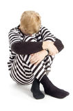Elderly criminal in jail suit Stock Images