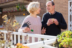 Elderly cuople talking at balcon Royalty Free Stock Image