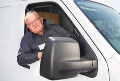 Elderly delivery man in a car. Royalty Free Stock Images
