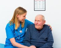 Elderly With Dementia. Geriatric doctor taking care of elderly men with dementia stock photography