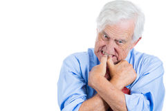 Elderly, desperate, mad, crazy looking man, biting his nails Stock Photo