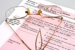Elderly and Disabled Taxes. Elderly and Disabled Tax Form and Glasses royalty free stock photo